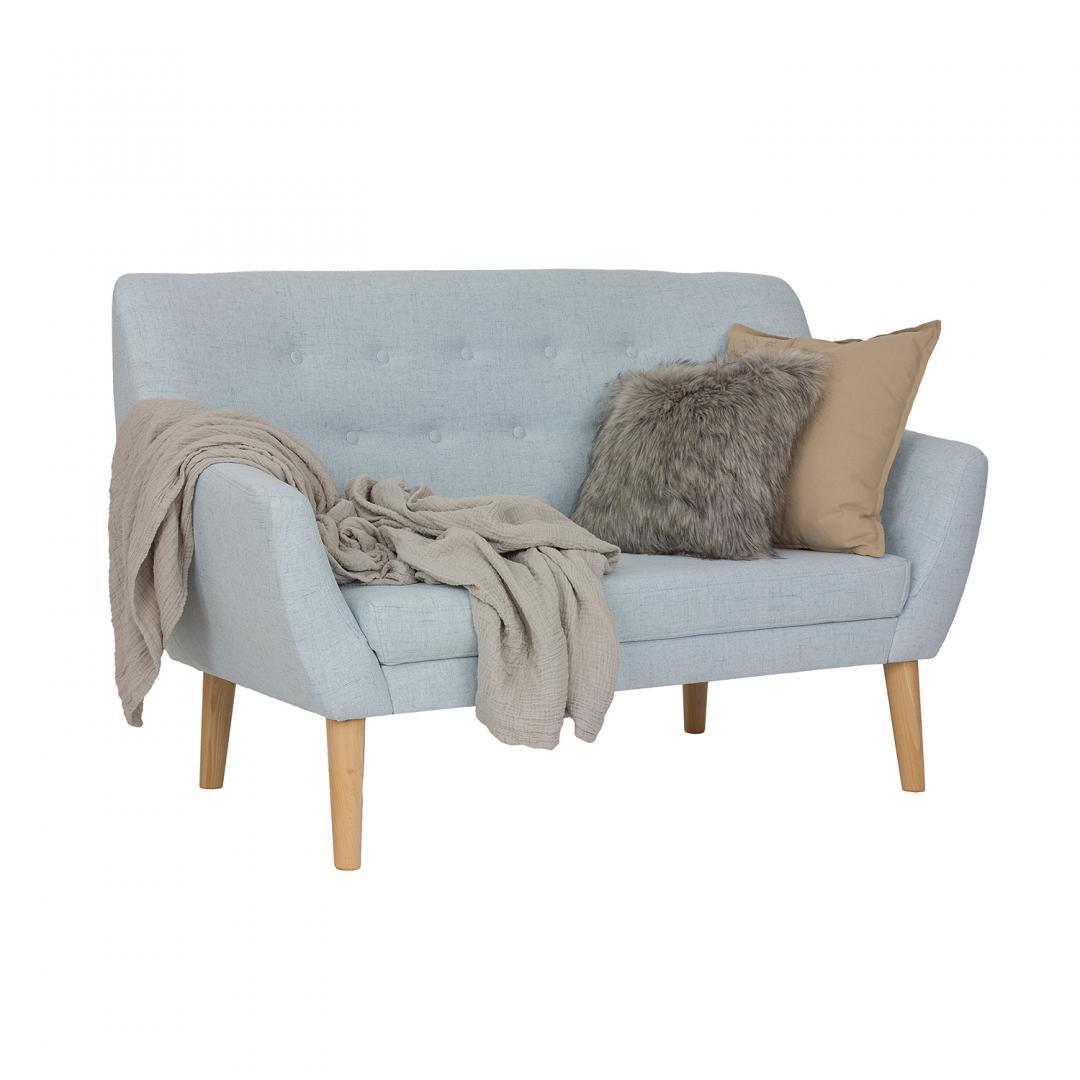 kanapa tapicerowana w kolorze niebieskim